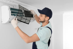 Professional air conditioner cleaning to improve performance